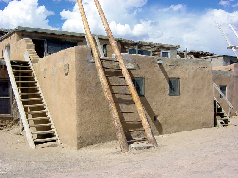 Houses In Acoma: People Go Up The Ladders To The Roof, Then Enter The House  Through A Hole In The Roof, And Down By Another Ladder.  The Ladders