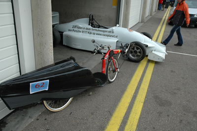 a recumbent and race car together