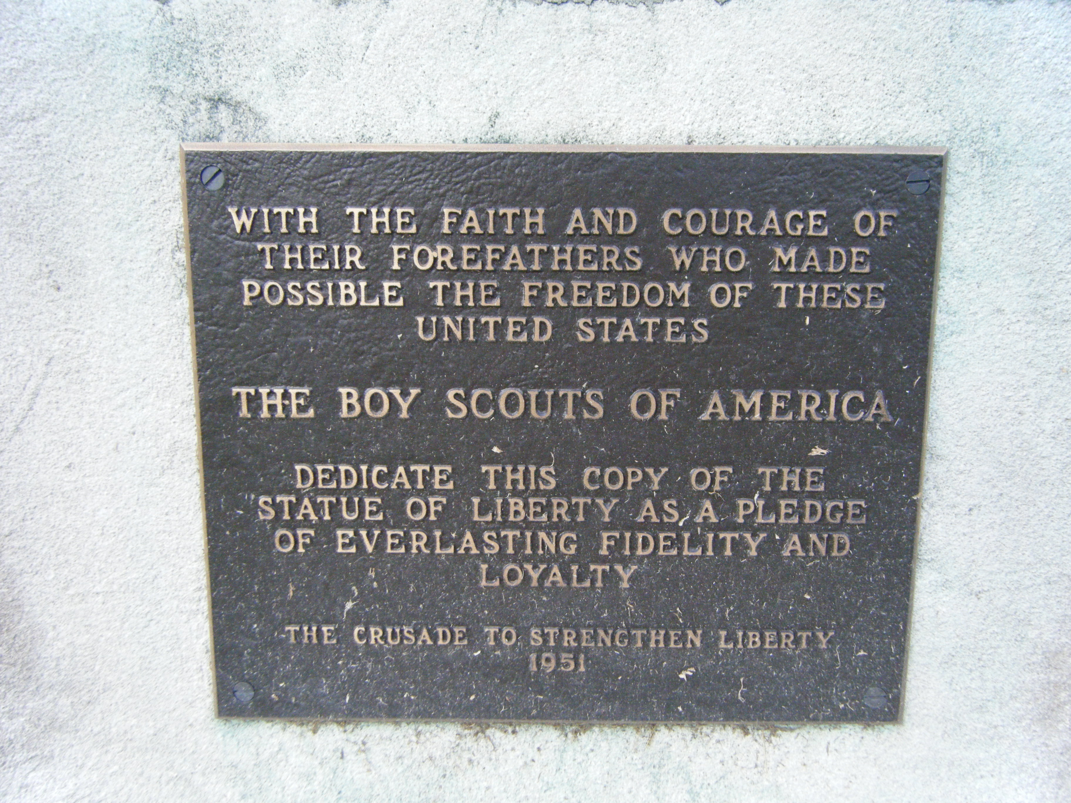 Copy of the Statue of Liberty contributed by the boy Scoutsin 1951 Memorial Plaque
