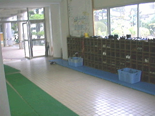 Japanese school lower hallway with fish pond out window to right. As you can see the first floor is very open, i.e. the only doors are to the classrooms. Gets windy sometimes! No central heating. Small space heaters in each room but kids hands are always chapped from the cold.