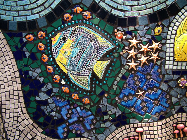 Mosaic wall section contains tiny tile, marble, ceramic tile and ...