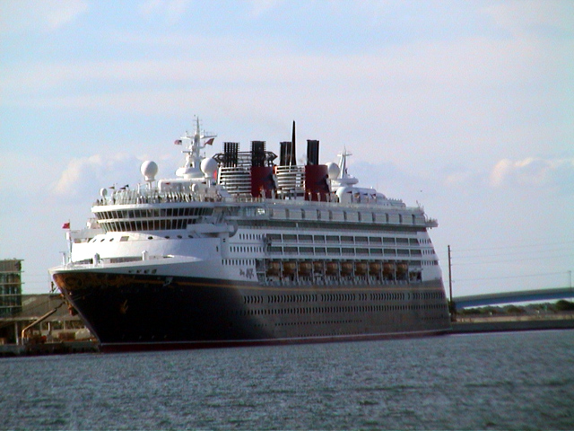 Front And Side View Of The Disney Magic Cruise Ship Docked At Port